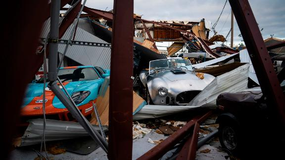Collector cars are covered in debris in Panama City on October 11.
