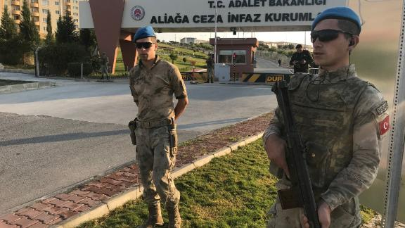 Turkish security officers outside the courthouse in Aliaga, Turkey, on Friday.