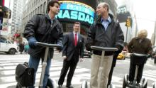Segway inventor Dean Kamen rides a Segway with Jeff Bezos in New York City in 2002.