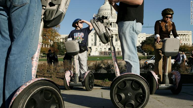 WASHINGTON - NOVEMBER 5: Tay Umstott of Potomac Falls, Virginia, and local resident Liz Strauss (R) ride the Segway Human Transporters during a Segway tour on the ground of Capitol Hill November 5, 2004 in Washington, DC. Tourists can now rent the two- wheeled, gyroscope-balanced scooter for sightseeing in the US capital.  (Photo by Alex Wong/Getty Images)