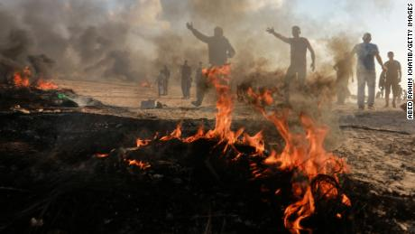 Palestinian demonstrators burn tires Friday in a protest on the Gaza-Israel border.