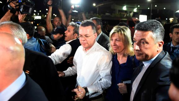 Pastor Andrew Brunson, center, and his wife Norine Brunson arrive at Adnan Menderes airport for a flight to Germany after his release following his trial in Izmir, Turkey, Friday, Oct. 12, 2018, A Turkish court on Friday convicted an American pastor of terror charges but released him from house arrest and allowed him to leave Turkey, in a move that is likely to ease tensions between Turkey and the United. (AP Photo/Emre Tazegul)