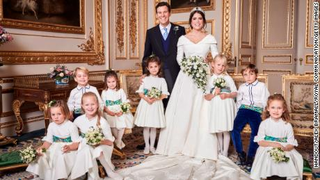 Prince George smiles for the camera, at left, sitting next to his sister, Princess Charlotte.