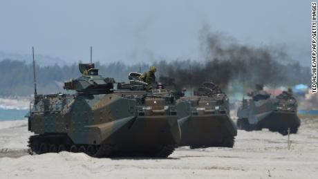 Japanese Ground Self Defense Forces' amphibious assault vehicles hit the beach during an amphibious landing exercise in the Philippines in 2018.