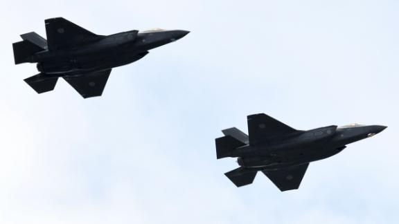 F-35 fighter aircraft from the Japan Air Self-Defense Force take part in a military review at the Ground Self-Defence Force's Asaka training ground in Asaka, Saitama prefecture on October 14, 2018.