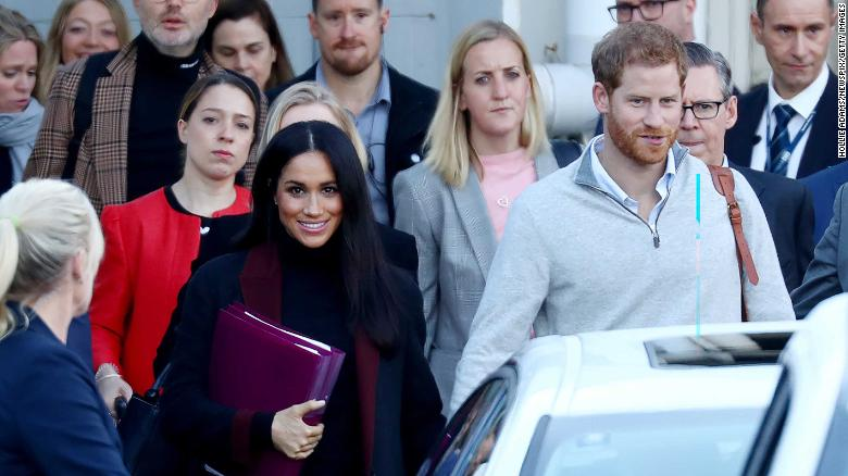 Prince Harry and wife Meghan pictured arriving into Sydney on Monday.