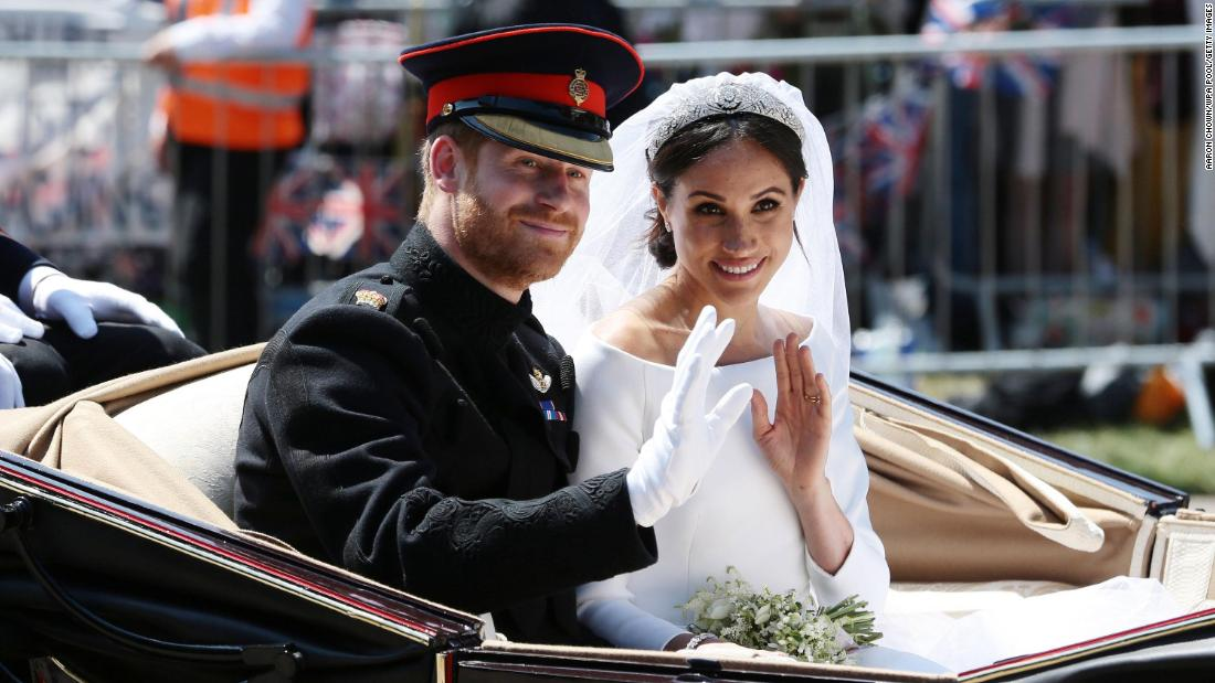 "Just after<a href=""https://edition.cnn.com/interactive/2018/05/world/royal-wedding-cnnphotos/"" target=""_blank""> getting married,</a> the newlyweds wave during their carriage procession in Windsor, England. <a href=""https://www.cnn.com/interactive/2018/05/world/royal-wedding-gigapixel/index.html"" target=""_blank"">Zoom in for a closer look</a>"