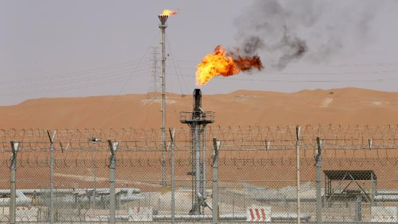 Flames are seen at the production facility of Saudi Aramco's Shaybah oilfield in the Empty Quarter, Saudi Arabian on May 22, 2018.
