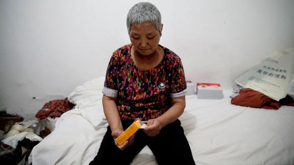 Cao Ruizhe in her rented hotel room, awaiting her next cancer treatment.