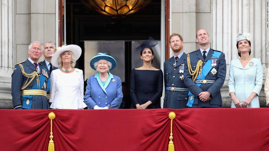 Members of the royal family watch a flyover in July during an event marking the centenary of the Royal Air Force. From left are Prince Charles; Prince Andrew; Camilla, the Duchess of Cornwall; Queen Elizabeth II; Meghan, the Duchess of Sussex; Prince Harry; Prince William; and Catherine, the Duchess of Cambridge.