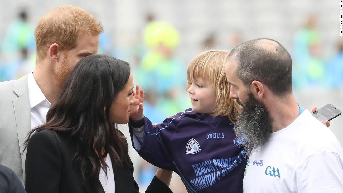 "Walter Cullen, 3, reaches out to touch Meghan's hair as the royal couple visited Dublin, Ireland, in July. It was <a href=""https://www.cnn.com/2018/07/10/europe/duke-duchess-sussex-first-official-international-trip-ireland-intl/index.html"" target=""_blank"">their first official trip together</a> since getting married."