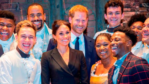 "Meghan and Harry pose with the cast and crew of the musical ""Hamilton"" after a performance in London in August 2018. Harry gave those in the theater something to remember after breaking into mock-song at the end of the show. The show was held to raise money for his HIV charity, Sentebale."