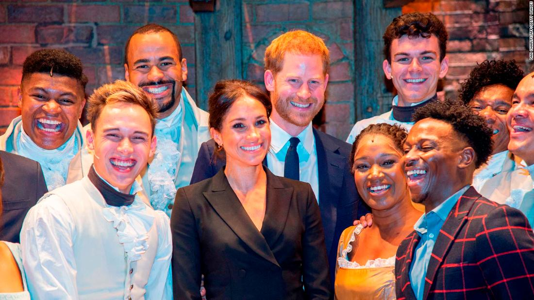 "Meghan and Harry pose with the cast and crew of the musical ""Hamilton"" after a performance in London in August. Harry gave those in the theater something to remember after <a href=""https://www.cnn.com/2018/08/30/uk/prince-harry-meghan-markle-hamilton-intl/index.html"" target=""_blank"">breaking into mock-song</a> at the end of the show. The show was held to raise money for his HIV charity, Sentebale."