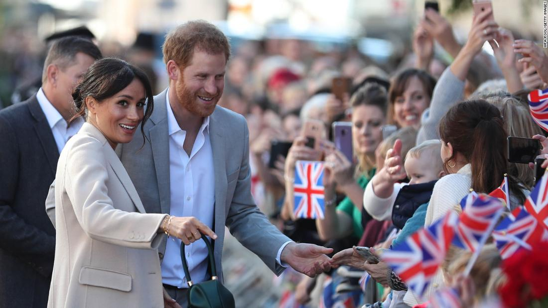 "Meghan and Harry greet well-wishers as they arrive for an event in Chichester, England, in October. They were <a href=""https://www.cnn.com/2018/10/03/uk/harry-meghan-sussex-visit-intl/index.html"" target=""_blank"">exploring Sussex,</a> the region from which their royal titles originate."
