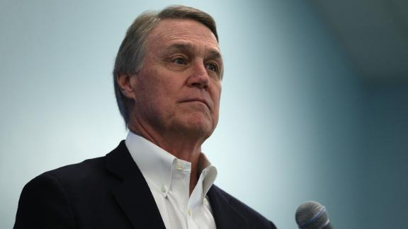 WHITE SULPHUR SPRINGS, WV - FEBRUARY 01: U.S. Sen. David Perdue (R-GA) listens during a news briefing at the 2018 House & Senate Republican Member Conference February 1, 2018 at the Greenbrier resort in White Sulphur Springs, West Virginia. Congressional Republicans gather at their annual retreat, hosted by the Congressional Institute, to discuss legislative agenda for the year. (Photo by Alex Wong/Getty Images)