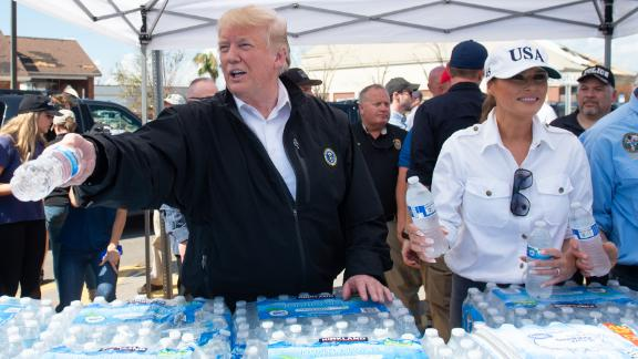 The President and first lady hand out bottles of water to people in Lynn Haven on October 15.