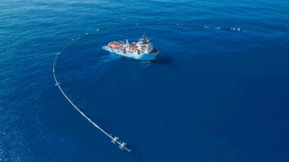 The Ocean Cleanup uses a U-shaped pipe to collect plastic. The company's goal is to clean the world's oceans.