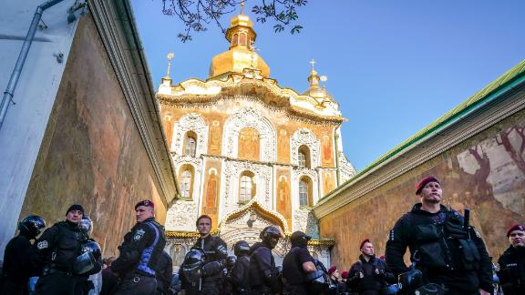 Policemen stand guard in front of the central entrance of the Kiev Pechersk Lavra monastery on October 11.
