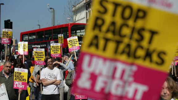 Demonstrators gather with placards during a protest called by the