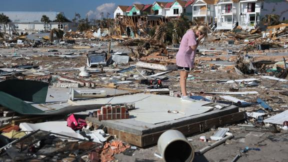 "MEXICO BEACH, FL - OCTOBER 15:  Lisa Patrick is overcome with emotion as she visits the remains of her home to see if she can salvage anything after it was destroyed by Hurricane Michael as it passed through the area on October 15, 2018 in Mexico Beach, Florida. After seeing that only the concrete slab remained of the home, Lisa said, ""It"
