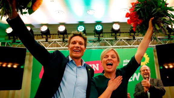 Katharina Schulze and Ludwig Hartmann, co-leaders of the Green Party in Bavaria, celebrate the results Sunday evening.