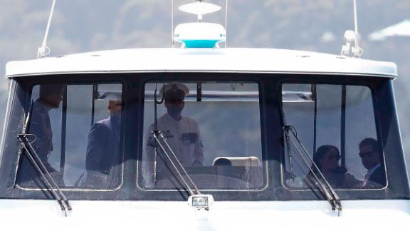 The Duke and Duchess ride in a boat across the Sydney Harbor en route to the opera house.