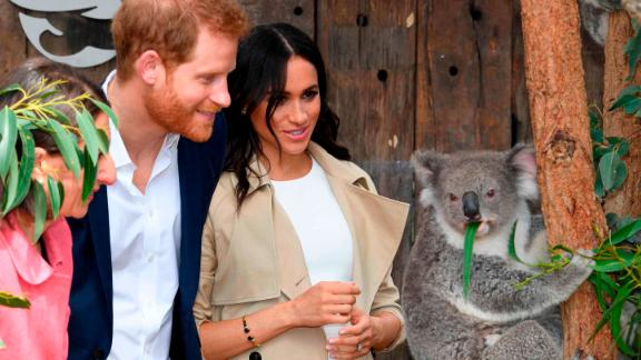 Harry and Meghan meet a koala, named Ruby, and its joey, named Meghan, in honor of the duchess, during a visit on Tuesday, October 16, to Taronga Zoo in Sydney.