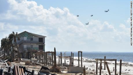 The presidential helicopter Marine One is seen flying along with Osprey planes over the areas destroyed by Hurricane Michael, in Mexico Beach, on October 15, 2018. - HECTOR RETAMAL/AFP/Getty Images