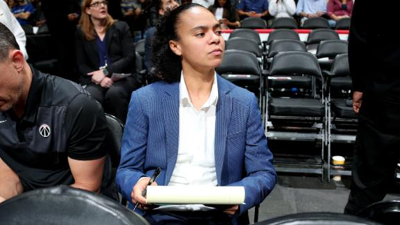 WASHINGTON, D.C. - OCTOBER 5: Kristi Toliver sits on the bench as an assistant coach of Washington Wizards during a pre-season game against the Miami Heat on October 5, 2018 at Capital One Arena, in Washington, D.C.  NOTE TO USER: User expressly acknowledges and agrees that, by downloading and/or using this Photograph, user is consenting to the terms and conditions of the Getty Images License Agreement. Mandatory Copyright Notice: Copyright 2018 NBAE (Photo by Ned Dishman/NBAE via Getty Images)