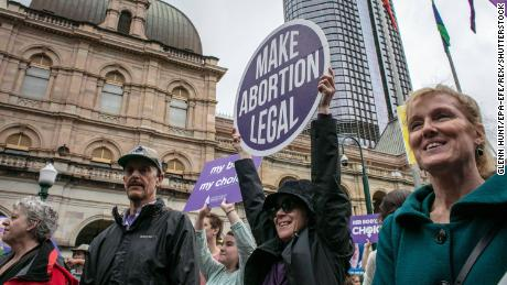 People attend a an abortion-rights march in Brisbane ahead of Wednesday's vote.