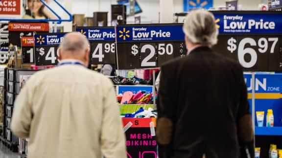 Customers shop at a Walmart Inc. store in Secaucus, New Jersey, U.S., on Wednesday, May 16, 2018. Walmart is scheduled to release earnings figures on May 17. Photographer: Timothy Fadek/Bloomberg via Getty Images
