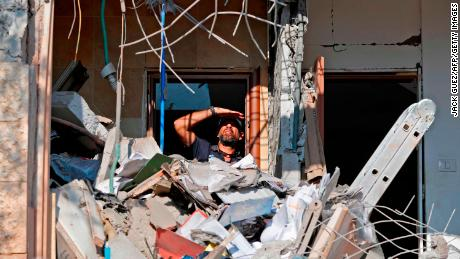 An Israeli sapper checks a house in the Israeli city of Beer Sheva after it was hit by a rocket fired from Gaza.