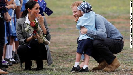 Prince Harry and Meghan get a hug from 5-year-old Luke Vincent at Dubbo Airport after arriving in the rural New South Wales town.
