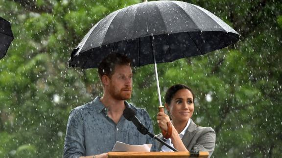 Prince Harry speaks as a rare, welcome outbreak of rain falls in Dubbo, in rural New South Wales.