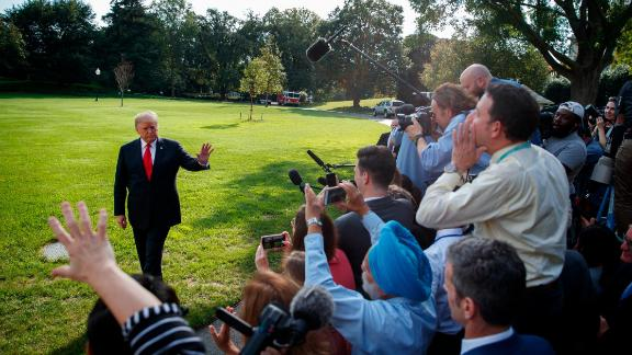 President Donald Trump talks with reporters on the South Lawn of the White House, Tuesday, Oct. 9, 2018, in Washington.