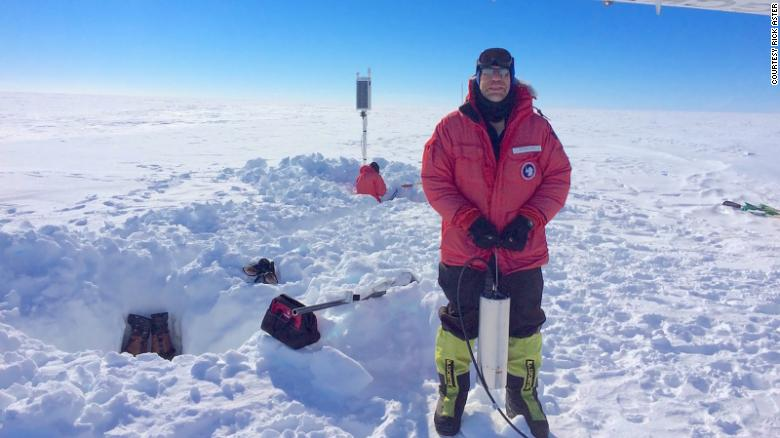 Researcher Rick Aster installs a broadband seismometer in Antarctica's Ross Ice Shelf.
