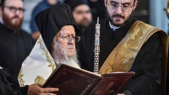 Ecumenical Patriarch Bartholomew I prays at the Hagia Triada Greek Orthodox church in Istanbul in September 2018.