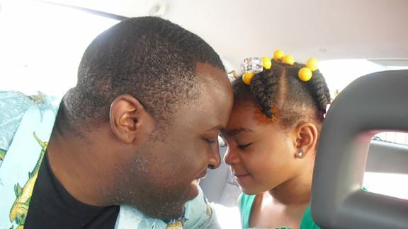Chinedu Okobi pictured with his daughter.