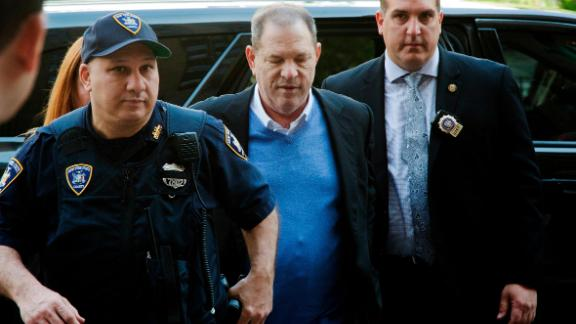 NYPD Detective Nicholas DiGaudio, right, escorts Harvey Weinstein into court in May 2018.