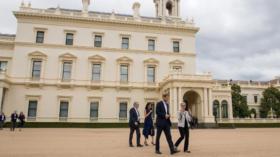 Governor of Victoria Linda Dessau and her husband, Anthony Howard, walk with Harry and Meghan at a reception at Government House in Melbourne.