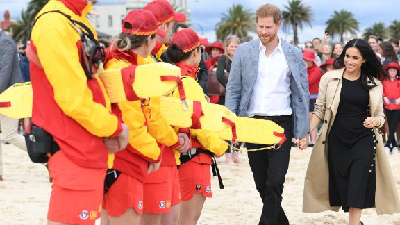 Harry and Meghan speak with surf life savers at South Melbourne beach.