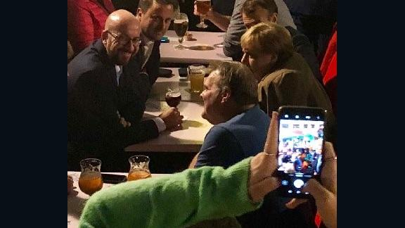 From left to right, Belgian Prime Minister Charles Michel, Luxembourg PM Xavier Bettel, French President Emmanuel Macron and German Chancellor Angela Merkel enjoy a beer in Brussels on October 17.