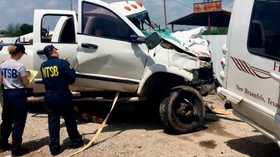 In this March 31, 2017 file photo provided by National Transportation Safety Board, Kristin Poland and David Pereira examine the pickup truck involved in a crash on March 29 on U.S. 83 near Garner State Park in Texas. Federal officials say a motorist