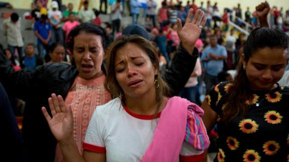 Honduran migrants pray at an improvised shelter in Chiquimula, Guatemala, on Tuesday.