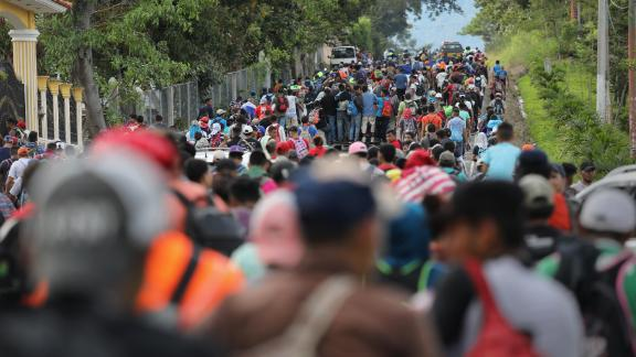 The caravan moves north after crossing the border from Honduras into Guatemala on Monday.