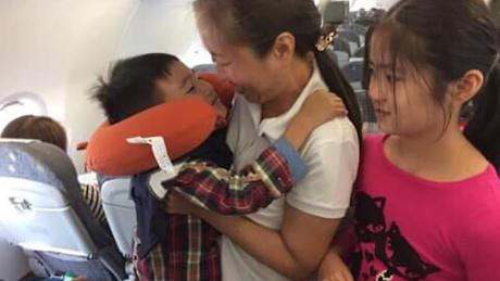 A photo published by the Committee to Protect Journalists (CPJ) purportedly shows Nguyen and her two children on a flight bound for the US.