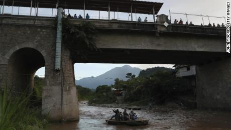 This file photo of August 9, 2018 shows an area where people cross the Suchiate River from Guatemala to Mexico. The illegal crossroads are located just below the international bridge connecting the two countries, bypassing immigration and customs controls.