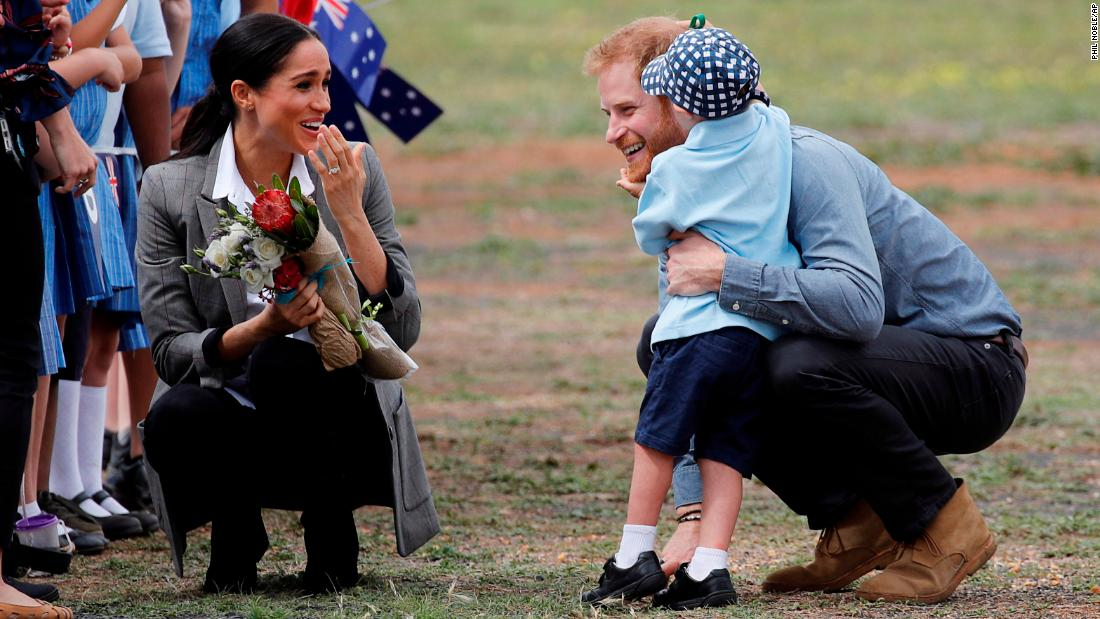 "Britain's Prince Harry and Meghan, Duchess of Sussex are embraced by Luke Vincent, 5, <a href=""https://www.cnn.com/2018/10/16/world/gallery/harry-meghan-royal-tour-october-2018-intl/index.html"" target=""_blank"">on their arrival in Australia</a> on Wednesday, October 17. Harry and Meghan will have a 16-day tour of Australia and the South Pacific."