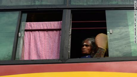 A Hindu devotee looks out from a shuttle bus going to the temple.