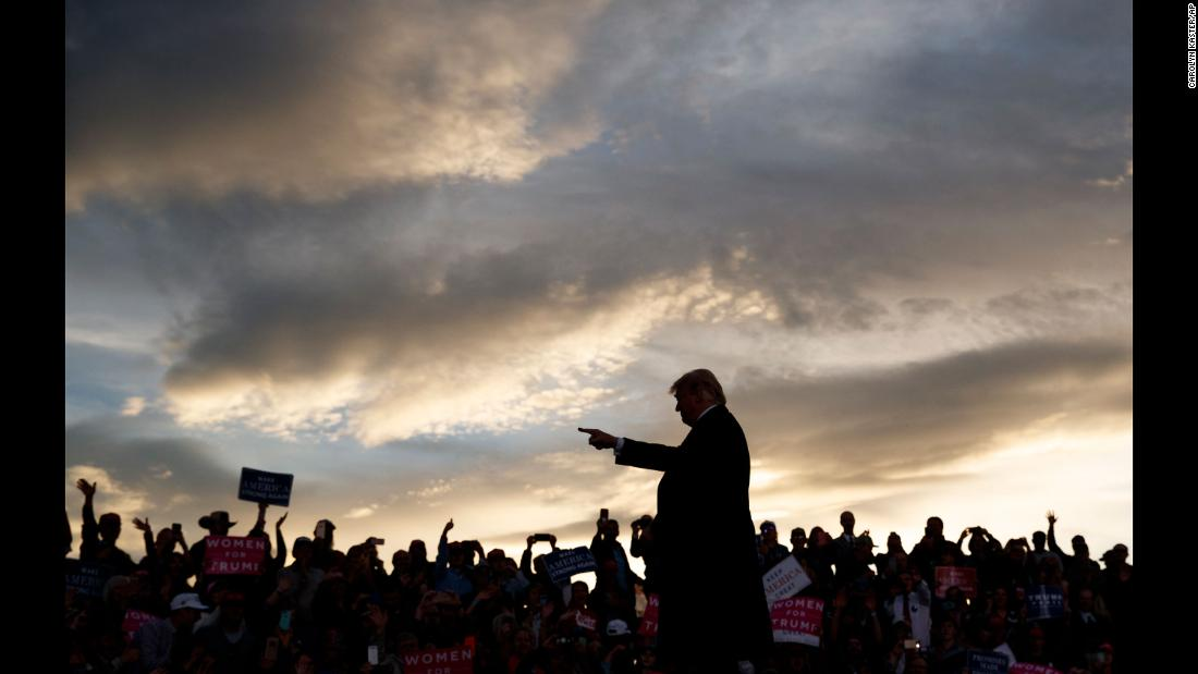 President Donald Trump arrives at a campaign rally in Missoula, Montana, as the sun sets on Thursday, October 18.